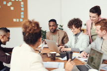 A group of people in a board room meeting working