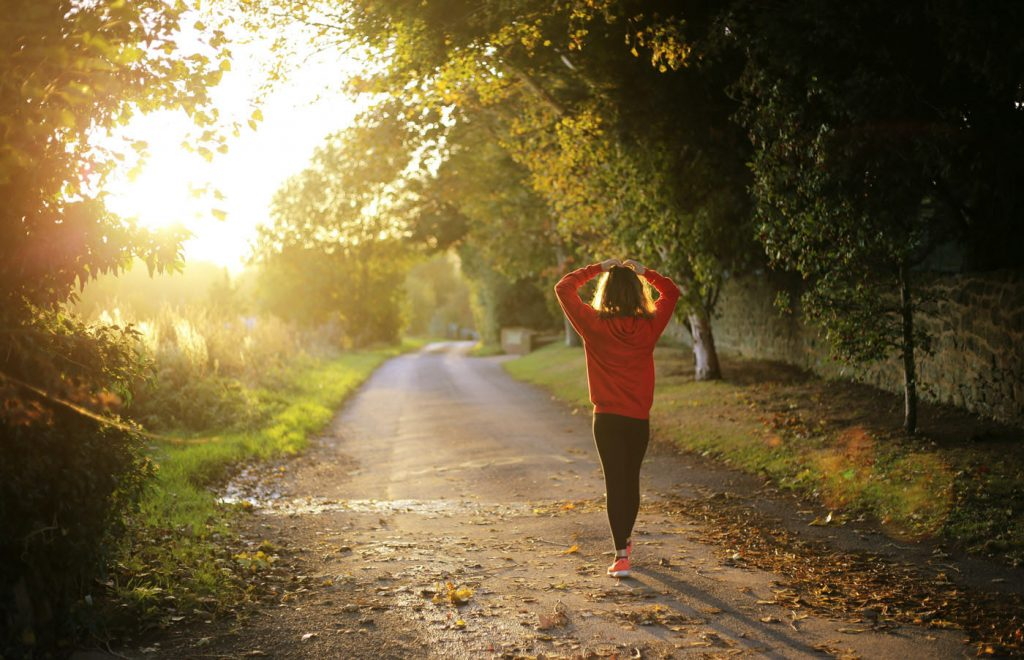 Woman jogging on a trail in the country