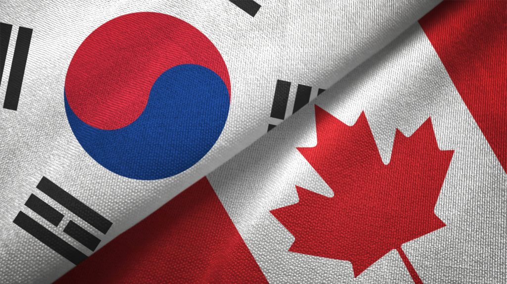 South Korea and Canada flags together textile cloth, fabric texture