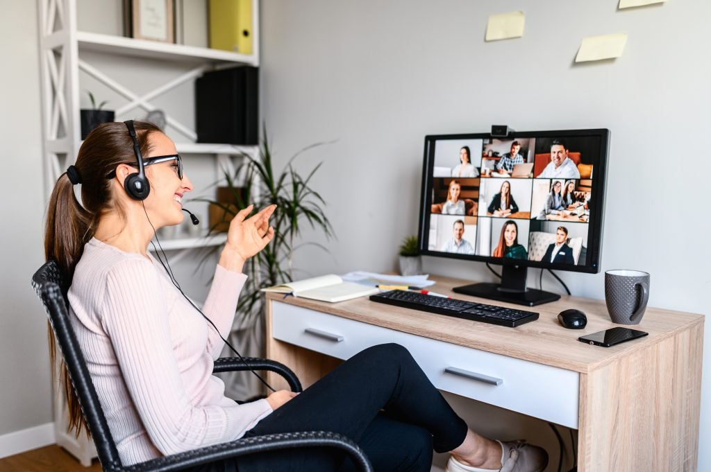 Woman with a headset having a virtual meeting