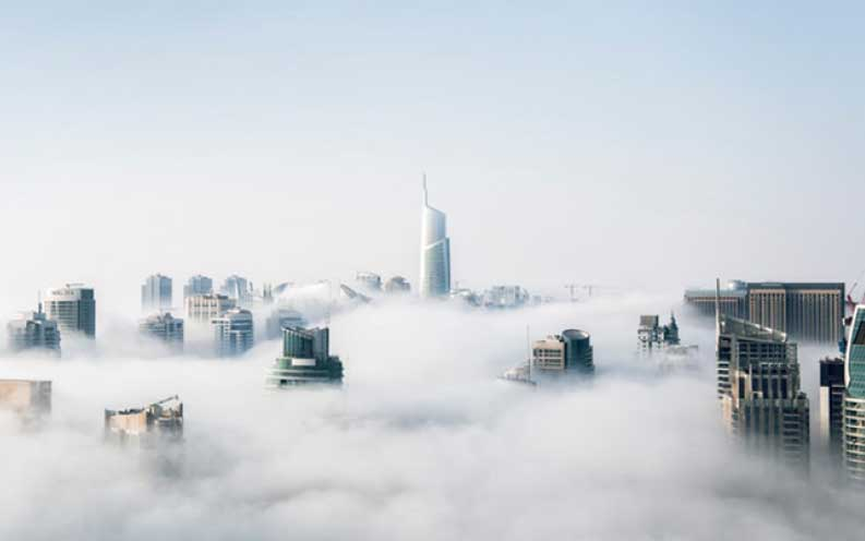 A scene of a city above the clouds.