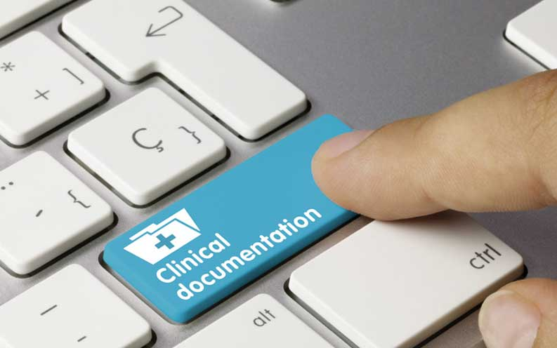 """A finger pressing a blue keyboard key which reads """"Clinical Documentation"""""""