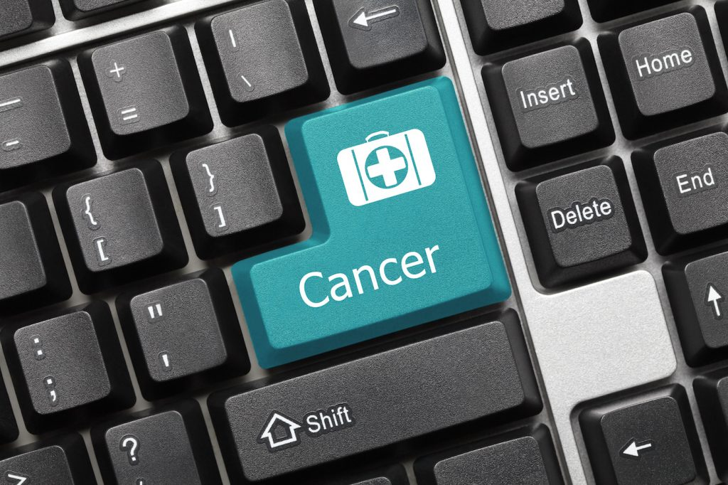 """Computer keyboard featuring a key labeled """"cancer."""""""