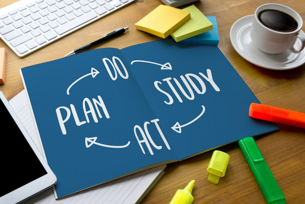 A notebook with the plan, do, study, act model showing