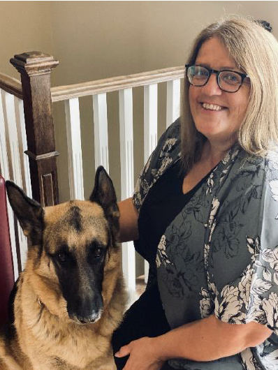 A photo of Charmaine Chisholm on the right and her german shepherd on the left